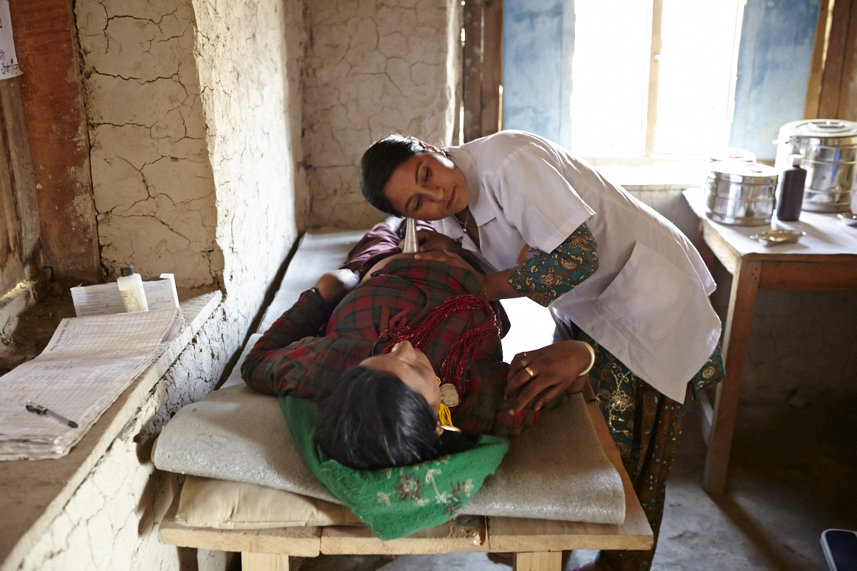 Maila health post Humla: a PHASE Auxilary Nurse Midwife listens to baby's heartbeat